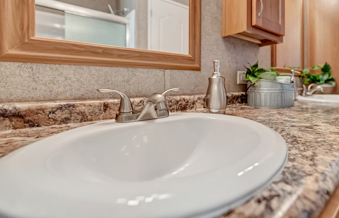 Metal Faucets w/ Oval Ceramic Sinks